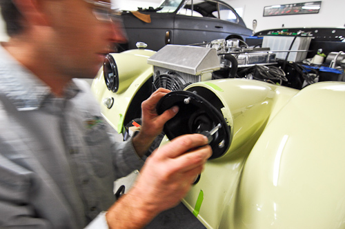 Karl installing headlight buckets on the Morgan.